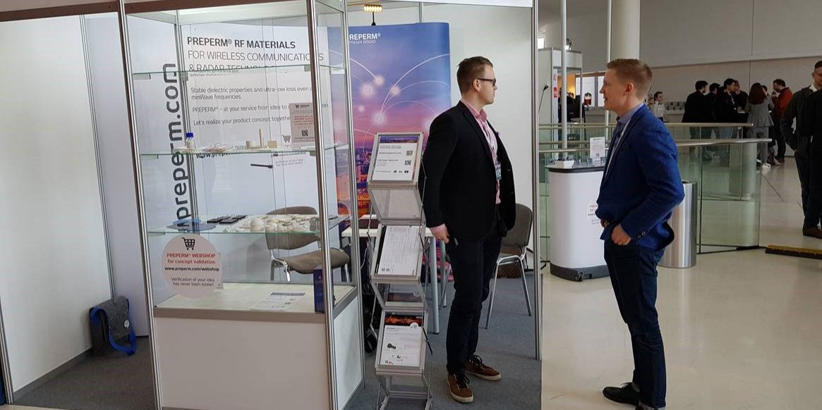 Premix booth and Business Manager Victor Heinänen and RF Technology Manager Jan Järveläinen ready for action on the first exhibition day.
